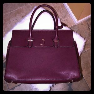 Maroon bag w gold accents. Stored in Duster Bag.
